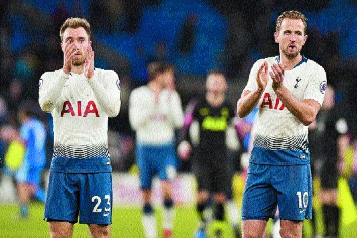 Record-equalling Kane keeps Spurs in title hunt