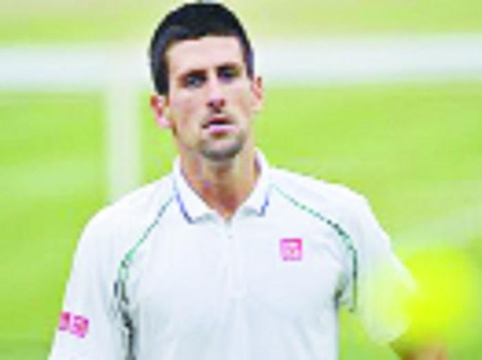 Djokovic advances to last eight