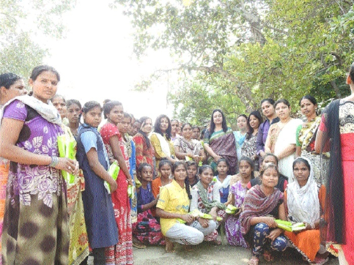 Members of SECRWWO distribute sanitary napkins
