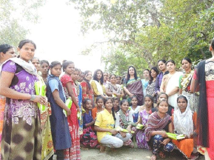 Members of SECRWWO distribute sanitary napkins