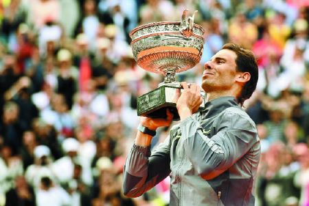 Nadal claims record-stretching 12th title