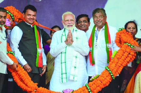Modi blasts Sena 'loudmouths' without naming them on Temple