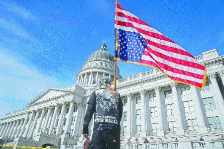 Heavily fortified US Statehouses see small protests by Trump supporters