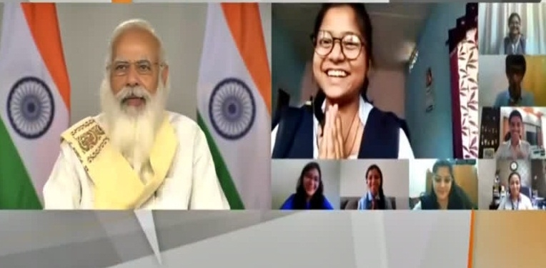 PM interacts with student